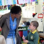 Mary Jane talks to a pupil at Wolvercote School
